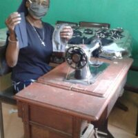 Sister Cellie sewing masks